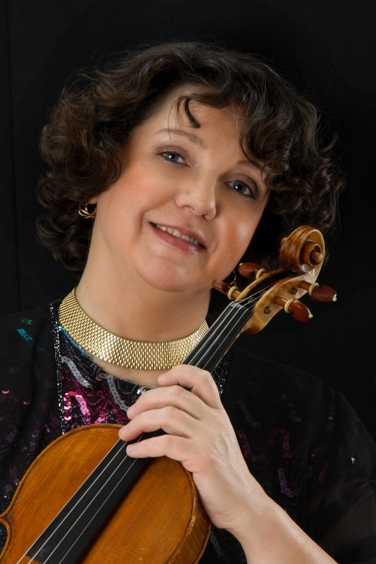 Faculty member portrait and her violin