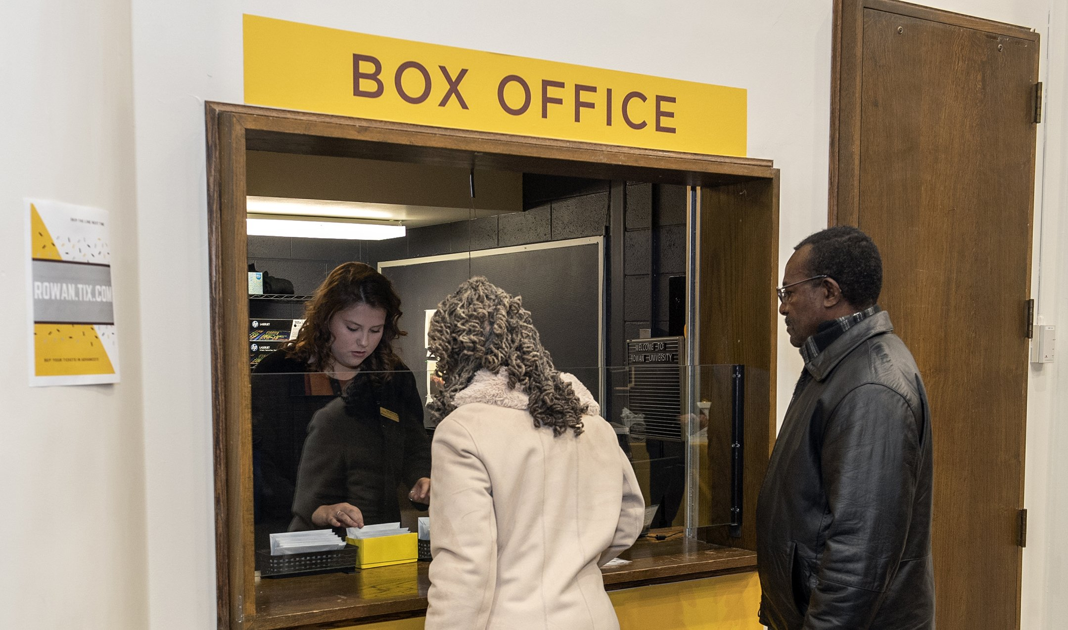 Cashier Lydia assisting patrons with ticketing at the Pfleeger Concert Hall box office window