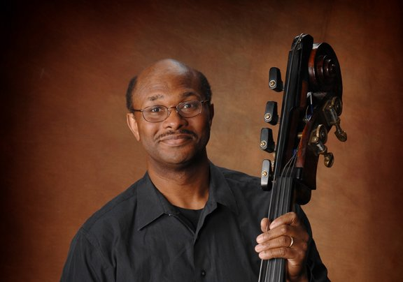 A Portrait of Douglas Mapp holding an upright bass