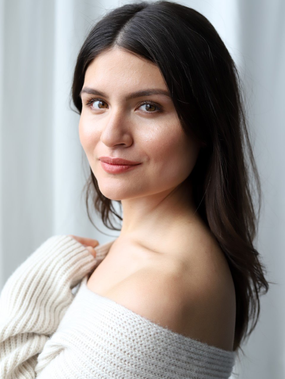Phillipa Soo headshot. She is wearing a beige off-the-shoulder sweater.